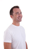Portrait of a handsome middle-age man smiling. On white background. Studio shot royalty free stock images