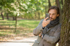 Portrait of handsome middle-aged man in the park Stock Photos