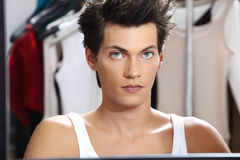 Portrait of handsome model at mirror in dressing room Stock Photo