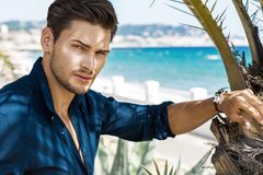 Portrait of handsome model with sea view stock photography