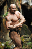 Portrait of a handsome muscular bodybuilder posing outdoors Royalty Free Stock Images