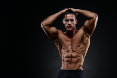 Portrait of a handsome muscular bodybuilder posing Stock Photo