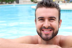 Portrait of a handsome natural man in the pool.  Royalty Free Stock Photography