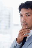 Portrait of a handsome office worker thinking. While looking at the camera Stock Photo