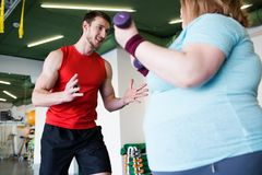 Personal Trainer Working with Client royalty free stock image