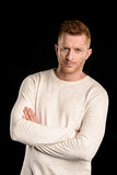 Portrait of handsome redhead man with crossed arms. Isolated on black Royalty Free Stock Photography