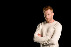 Portrait of handsome redhead man with crossed arms. Isolated on black Royalty Free Stock Photos