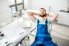 Repairman at the office stock photography