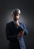 Portrait of a handsome sailor on a dark background Stock Photo