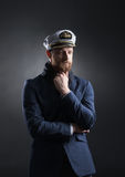 Portrait of a handsome sailor on a dark background Stock Photography
