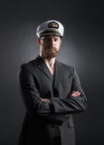 Portrait of a handsome sailor on a dark background Royalty Free Stock Images