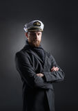 Portrait of a handsome sailor on a dark background Royalty Free Stock Photography
