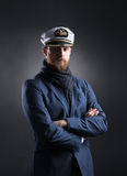 Portrait of a handsome sailor on a dark background Royalty Free Stock Image