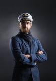 Portrait of a handsome sailor on a dark background Royalty Free Stock Photo