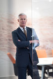 Portrait of handsome senior business man at modern office Stock Photography
