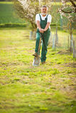 Portrait of a handsome senior man gardening in his garden Stock Photos