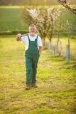 Portrait of a handsome senior man gardening in his garden Stock Photo