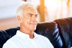 Portrait of a handsome senior man indoor. Portrait of a handsome senior man smiling indoor royalty free stock image