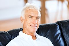 Portrait of a handsome senior man indoor. Portrait of a handsome senior man smiling indoor royalty free stock photo