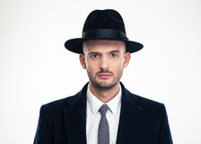 Portrait of handsome serious businessman in black suit and hat Stock Photo