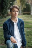 Portrait of Handsome and serious teen boy teen outdoors. royalty free stock photo