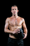 Portrait of handsome shirtless man holding nutritional supplement Royalty Free Stock Image