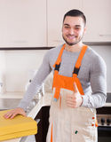Portrait of handsome skilled workman. At residential kitchen Royalty Free Stock Images