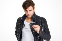 Portrait of a handsome smiling man in a leather jacket posing Royalty Free Stock Image