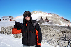 Portrait on a handsome smiling man on a ski slope background Stock Photos