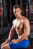 Portrait of handsome sportive man in gym. Beautiful relief male torso Stock Photo