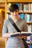 Portrait of a handsome student holding a book royalty free stock photo