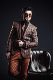 Portrait of handsome stylish man in elegant brown jacket Stock Photography