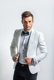 Portrait of handsome stylish man in white elegant suit Royalty Free Stock Images