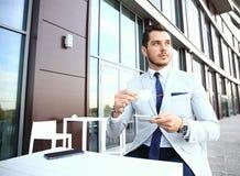 Portrait of handsome successful man drink coffee, business man having breakfast sitting on beautiful terrace Stock Image