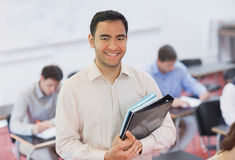 Portrait of handsome teacher posing in his classroom Royalty Free Stock Photo