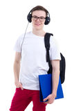 Portrait of handsome teenage boy with backpack and headphones is Royalty Free Stock Photography