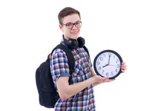 Portrait of handsome teenage boy with backpack and office clock Stock Photography