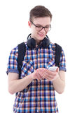 Portrait of handsome teenage boy with backpack, phone and headph Stock Image