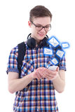 Portrait of handsome teenage boy sending messages with smart pho Royalty Free Stock Images
