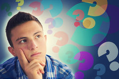 Portrait of handsome teenage boy thinking Stock Photo