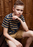 Portrait of handsome teenage happy boy outdoor in backyard Royalty Free Stock Photo