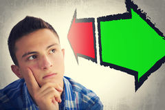 Portrait of handsome teenager faced with choice Royalty Free Stock Images