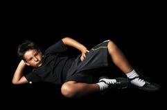 Portrait of handsome tennis boy lie down Royalty Free Stock Photos