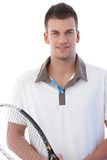 Portrait of handsome tennis player smiling Royalty Free Stock Image