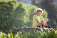 Boy in the park. Portrait of handsome thinkful boy in the park, copy space on left Royalty Free Stock Photography