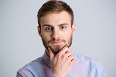 Portrait of handsome thoughtful young man with beard Stock Image