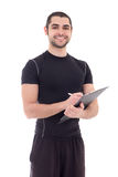 Portrait of handsome trainer in sportswear with clipboard isolat Stock Photo