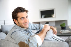 Portrait of handsome trendy young man in living room Royalty Free Stock Photo