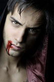 Portrait of a handsome vampire with blood Stock Image