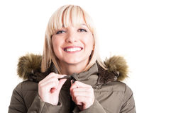 Portrait of handsome woman holding winter jacket zipper Stock Images